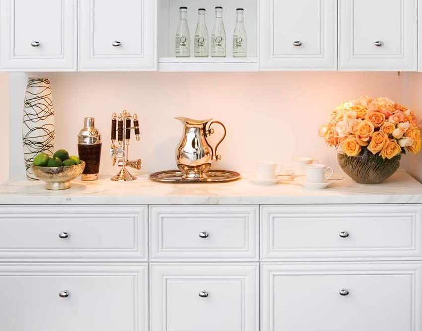 elegant-butler-pantry-with-clean-white-cabinets-glass-showing-case-and-lights-accenting-marble-top.jpg