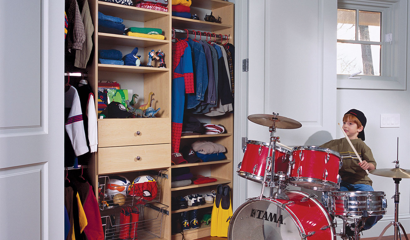 little-boys-reach-in-closet-equipped-with-enough-storage-for-clothes-and-other-items.jpg